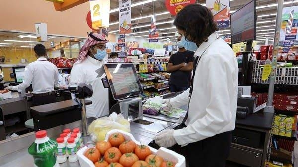 People wearing protective face masks and gloves shop at a supermarket in Riyadh. — Courtesy photo