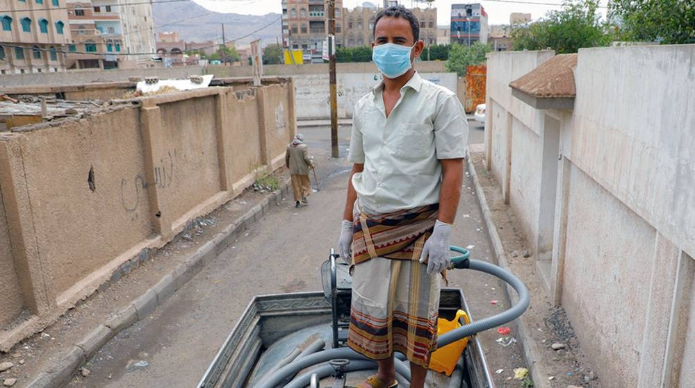 A man works on a water truck delivering water to communities in Sana'a, Yemen, where UNICEF is providing families with access to clean water during the COVID-19 pandemic. — courtesy photo UNICEF/Moohialdin Fuad