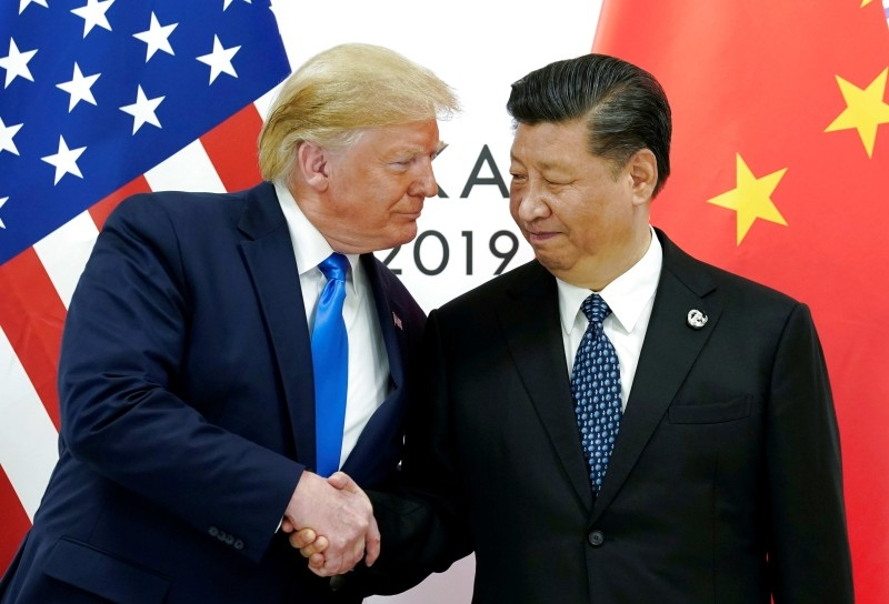 US President Donald Trump meets with China's President Xi Jinping at the G20 leaders summit in Japan, in this June 29, 2019 picture. — Courtesy photo