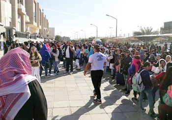 Filipino workers trying to get amnesty are seen waiting outside the Philippine Embassy in Kuwait City in this file picture. — Courtesy photo