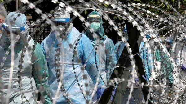 Medical workers wearing protective suits pass by barbed wire at the red zone under enhanced lockdown, amid the coronavirus outbreak in Petaling Jaya, Malaysia in this file photo. — Courtesy photo