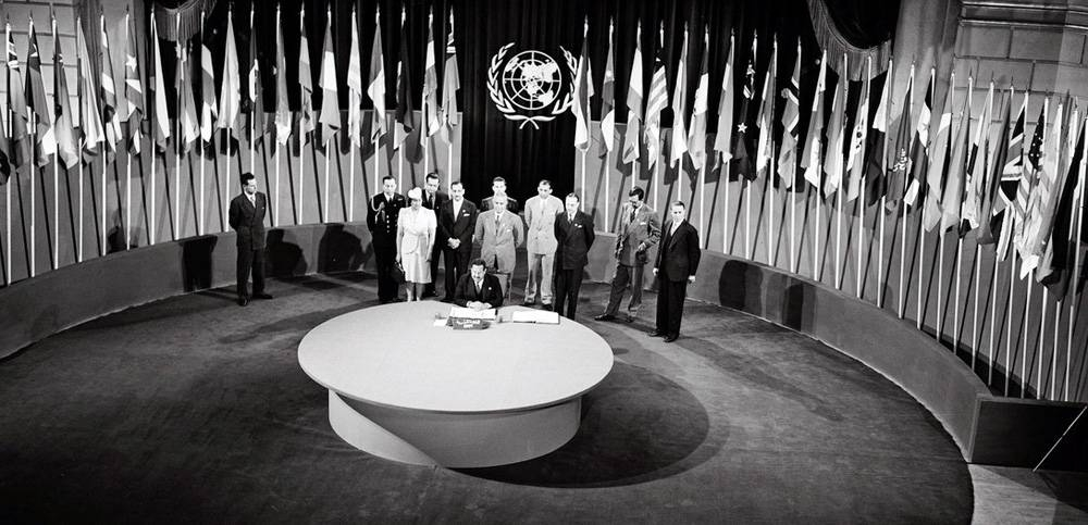 The UN Charter being signed by a delegation at a ceremony held at the Veterans' War Memorial Building on June 26, 1945. — courtesy UN Photo/Yould