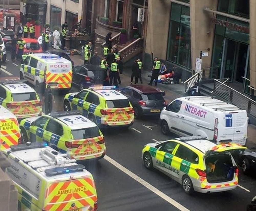 Scottish police cordon off a Glasgow city center area after three people were stabbed to death. — Photo courtesy Twitter