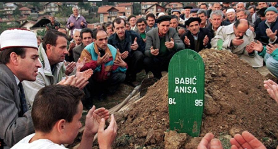 File photo of Bosnians at a grave of a Srebrenica genocide victim.