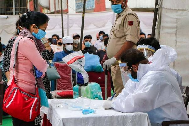 Medics conduct a health check-up for passengers at Jammu railway station following the resumption of passenger train services. — File photo