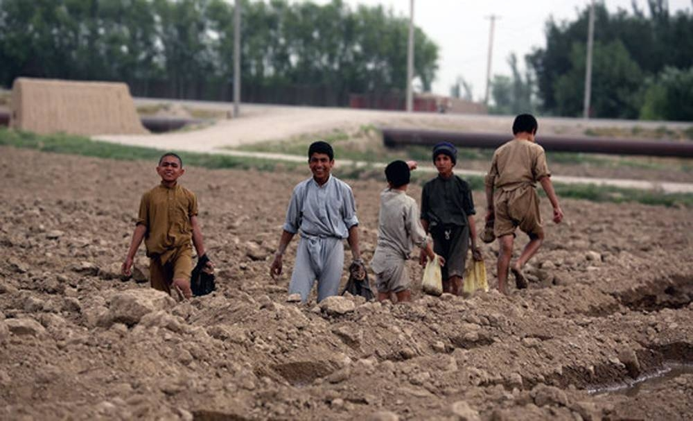 Child farmers help to level fields in Balkh Province, Afghanistan. — courtesy World Bank/Ghullam Abbas Farzami