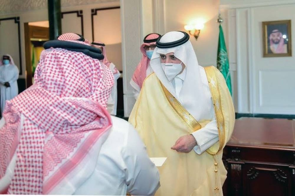 Emir of Tabuk Prince Fahd Bin Sultan distributes financial compensation to owners of properties in the NEOM project region at his office in Tabuk on Sunday.