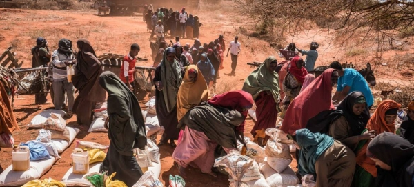 In the western desert town of Dinsoor, Somalia, newly arrived drought victims receive food supplies delivered by the UN's World Food Program. — File photo