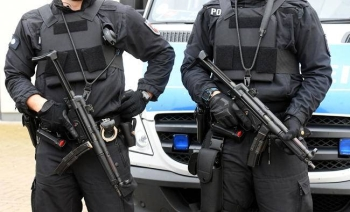 Policemen stand guard in Celle near Hanover, central Germany, in this file photo.