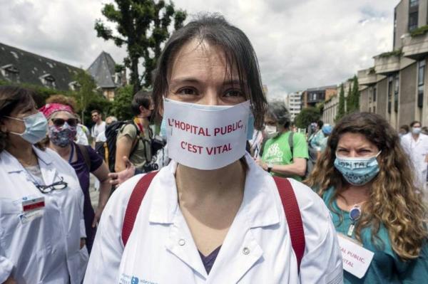 A health worker demonstration in Paris, France, June 2020. — courtesy Martin Barzilai / HAYTHAM-REA / Redux