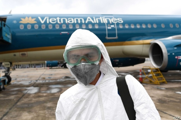 A worker wearing a protective suit prepares to disinfect a Vietnam Airlines plane amid concerns of the spread of the COVID-19 coronavirus at Noi Bai International Airport in Hanoi in this March 3, 2020 file picture. — Courtesy photo