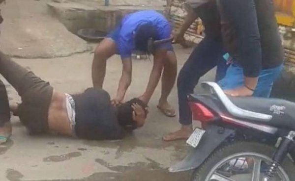 An unarmed Muslim man was savagely battered with a hammer near the Indian capital over suspicion of smuggling cow meat as the police watched the gruesome incident.— Courtesy photo