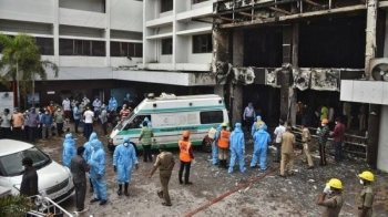 Rescue workers on Sunday look for survivors after a fire broke out in a hotel that was being used as a coronavirus disease (COVID-19) facility in Vijayawada, in the southern Indian state of Andhra Pradesh. — Courtesy photo
