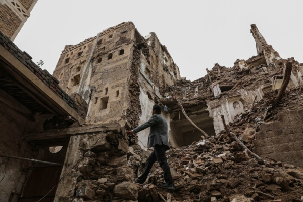 A man walks past a building collapsed by rain in the UNESCO World Heritage site of the old city of Sanaa.