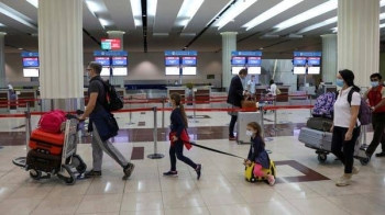 Passengers at Dubai International Airport as Emirates airline resumed limited outbound passenger flights amid the outbreak of the coronavirus disease. — File photo