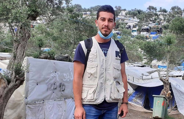 Shadi Mohammedali, a refugee from Gaza, now works for the International Rescue Committee (IRC). Here he is pictured in the Moria Refugee Camp in Greece. — courtesy IRC