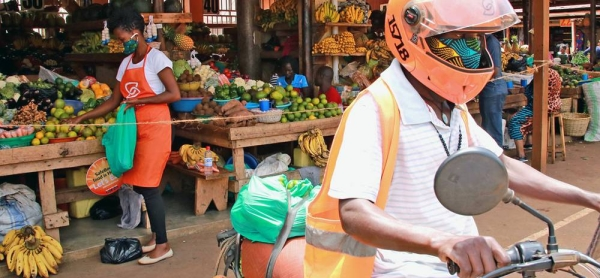 A SafeBoda rider and market vendor use the SafeBoda app to deliver food and supplies during the COVID-19 lockdown in Kampala, Uganda. — courtesy UNCDF