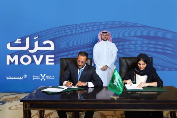 SFA Managing Director Shaima Saleh Al-Husseini and Tamer Mosalam, Gulf & Levant Foods Vice President and Business Unit General Manager at PepsiCo, signing a partnership deal on Sunday. — Courtesy photo