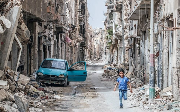 A child runs through the debris and wreckage in downtown Benghazi, Libya. — courtesy UNICEF/Giovanni Diffidenti