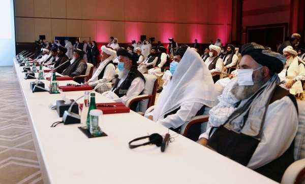 US Secretary of State Mike Pompeo speaks as Zalmay Khalilzad, US envoy for peace in Afghanistan, are seen during talks between the Afghan government and Taliban insurgents in Doha, Saturday.