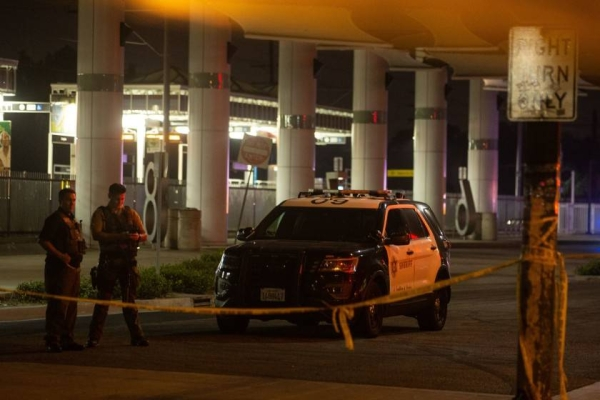 Deputies block off the scene near the bus station where two L.A. County sheriff's deputies were shot. — Courtesy photo