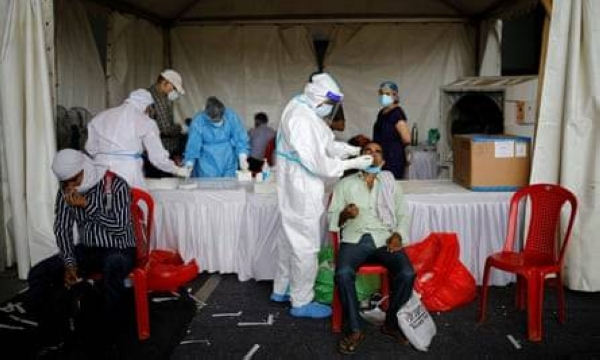 Healthcare workers at a Delhi bus terminal test for coronavirus amid a surge of cases in India. — Courtesy photo