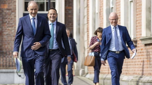 Irish Prime Minister Micheal Martin, Deputy Prime Minister Leo Varadkar and Health Minister Stephen Donnelly, outside the parliament building, Tuesday. — Courtesy photo