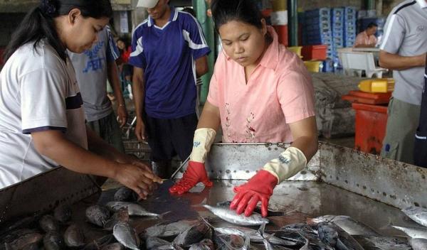 Burmese migrant worker in Bangkok, Thailand. — courtesy IOM/Benjamin Suomela