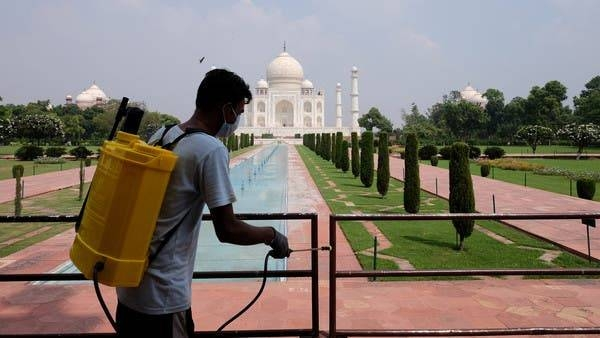 A worker sanitizes railings in the premises of Taj Mahal in Agra, India. — Courtesy photo