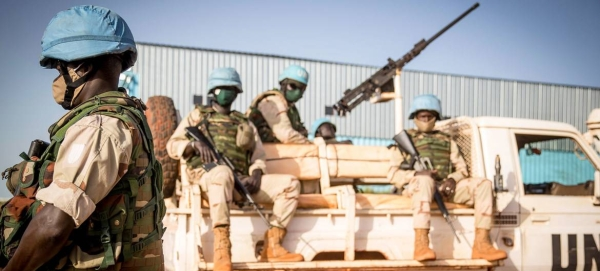 Peacekeepers serving with the UN's Multidimensional Integrated Stabilization Mission in Mali (MINUSMA) wear face masks while on patrol in this file picture. — Courtesy photo