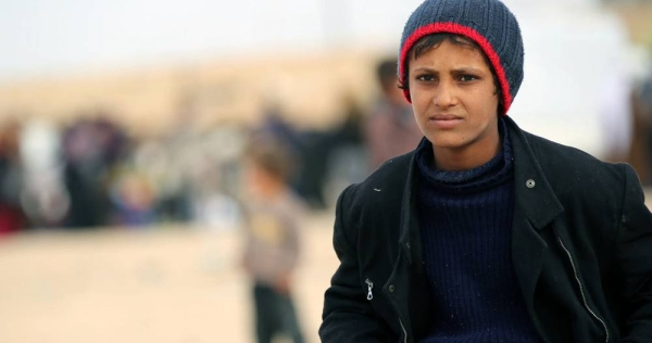 """A 12 year-old boy who fled to the Al-Hol camp in northeastern Syria says, """"it's very cold here and at night, the wind is so strong and cold that blankets are not enough to heat up"""". — courtesy UNICEF/Delil Souleiman"""