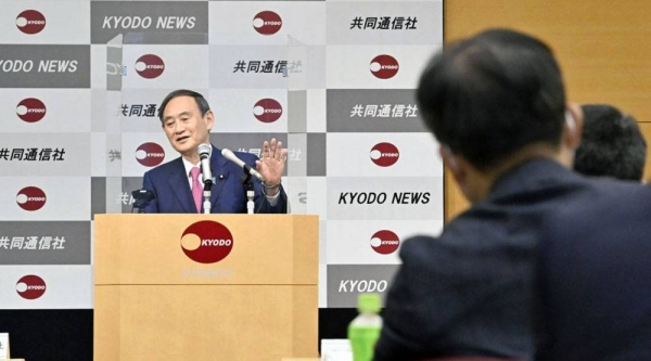 Japanese Prime Minister Yoshihide Suga makes a speech at the Kyodo News head office in Tokyo on Friday. — courtesy Kyodo
