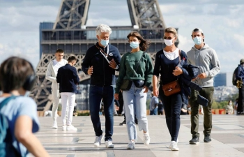 In Paris and eight other French cities, restaurants, bars, cinemas and other establishments were being forced to close no later than 9 p.m. to try to reduce contact among people.