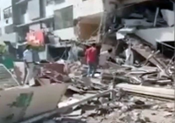 A video grab of the aftermath of an explosion in a multi-story building near Maskan Chowrangi in Karachi's Gulshan-i-Iqbal area on Wednesday.