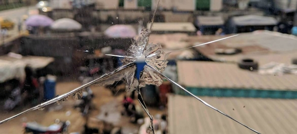 A view of a street in Lagos, Nigeria, through a shattered glass window. — Courtesy photo