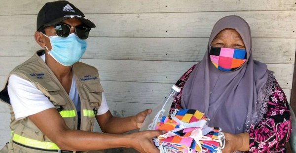 The UN Development Programme (UNDP) in Thailand and a local NGO arranged for the delivery of face masks to the ethnic community in Phuket province, located in the south of the country. — Courtesy photo