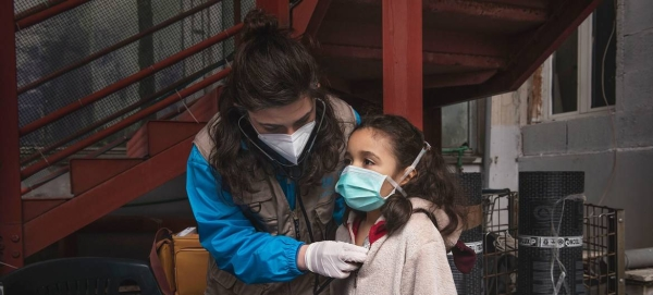 A girl receives a medical screening from Doctor Antonella Tochiaro in an informal settlement where she lives in Rome, Italy, in this file picture. — Courtesy photo