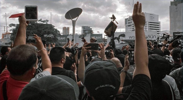 A demonstration takes place on the streets of Bangkok, Thailand. — courtesy Unsplash/Kitthitorn Chaiyuthapoo