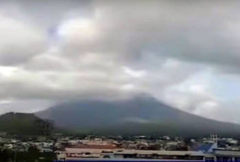 TV grab shows clouds over Bicol region, as tropical storm Molave was expected to bring widespread rains over two regions on the southern part of the main island of Luzon on Sunday.