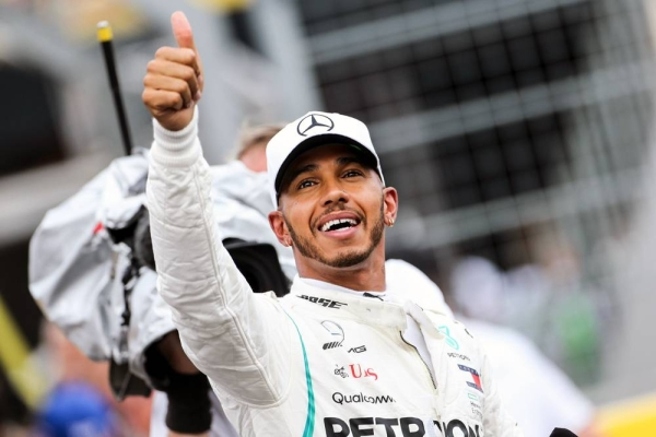 British driver Lewis Hamilton made Formula One history on Sunday, winning the Portuguese Grand Prix for a 92nd career victory to move one ahead of German great Michael Schumacher.