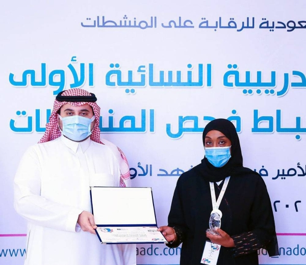 One of the trainees being presented with their doping control officer (DCO) certificates.