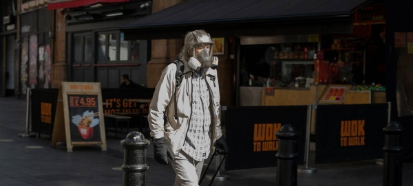 A masked man walking in London's West End in this file photo. — Courtesy photo