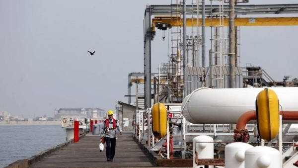 An Iranian laborer is seen walking the platform of the oil facility in Khark Island in this file photo. — AFP