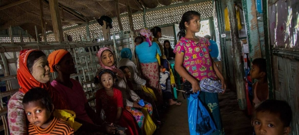 Women and children from a local community are seen at a health center in Sittwe, in Myanmar's northern Rakhine state, in this file picture. — Courtesy photo