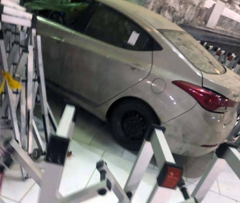 Picture of the crashed car into one of the doors of the Grand Mosque in Makkah on Friday. — courtesy Makkah region twitter