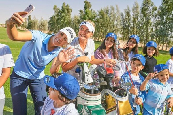 Camilla Lennarth & Amy Boulden teaching Saudi kids at a golf clinic in 2019.