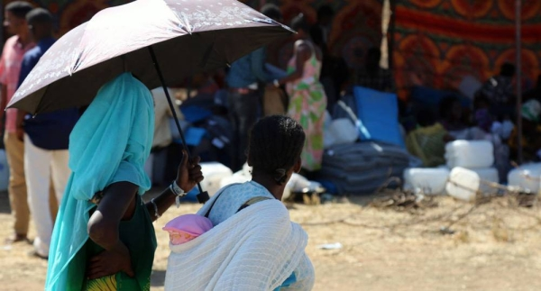A woman receives health services at a transit point in Hamdayet, Sudan. — courtesy UNFPA Sudan/Sufian Abdul-Mout