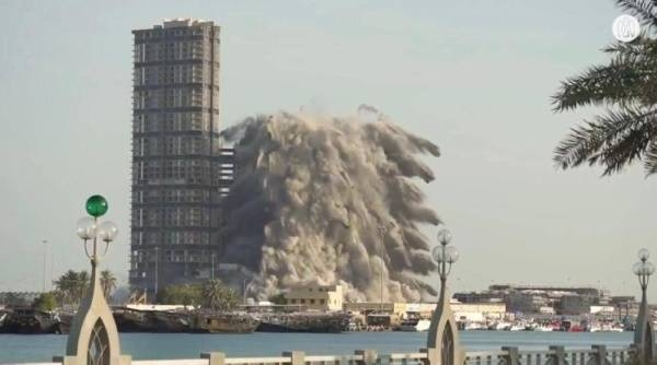 Modon Properties (Modon) announced on Friday the successful demolition of Mina Plaza towers in the Mina Zayed area, Abu Dhabi, setting a new Guinness World Records title for the tallest building demolished using explosives. — Courtesy photo