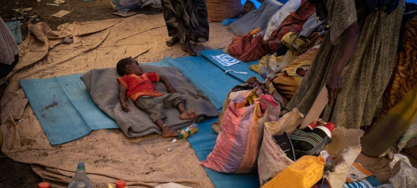 An Ethiopian refugee child sleeps on a mattress at a transit site in Hamdayet, Sudan, in this file photo. — Courtesy photo
