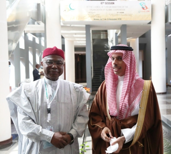 Saudi Foreign Minister Prince Faisal bin Farhan and Hussein Ibrahim Taha at the 47th session of the OIC Council of Foreign Ministers, in Niger on November 28, 2020. (Credit: @FaisalbinFarhan twitter)